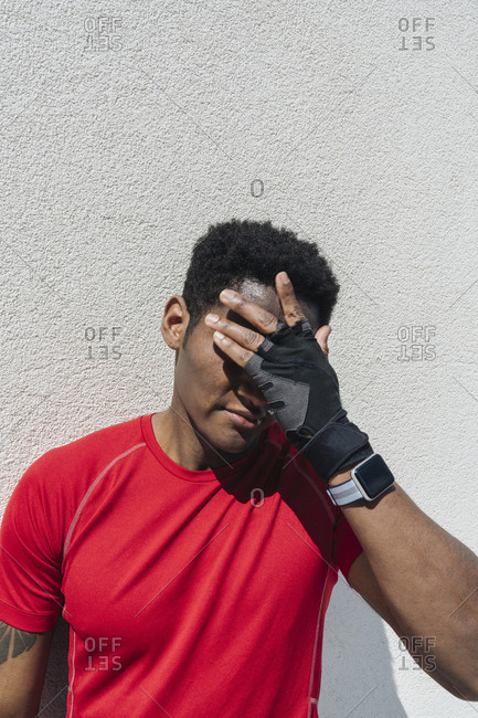 Portrait of sportsman wearing smartwatch and gloves