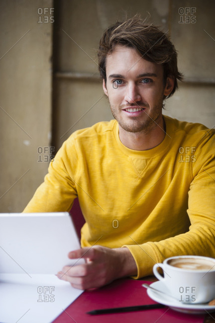 Portrait of young man with digital tablet in a coffee shop