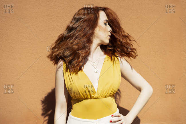 Redheaded woman moving her head