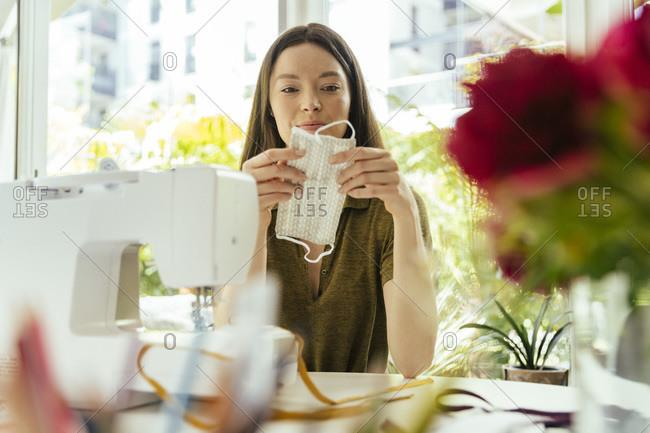 Woman sewing face masks at home
