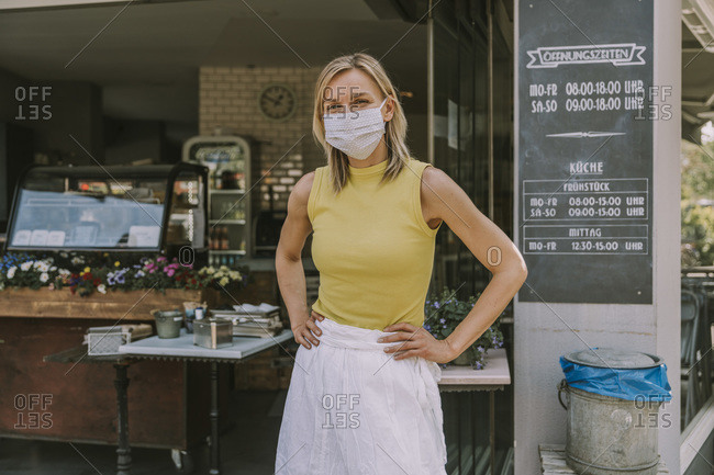 Portrait of confident cafe owner wearing face mask