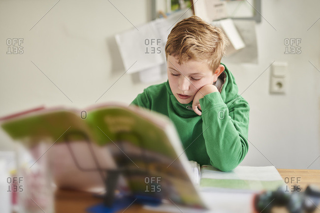 Boy studying school work at home