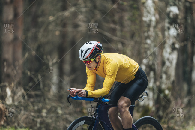 Young man in sports clothing riding bicycle
