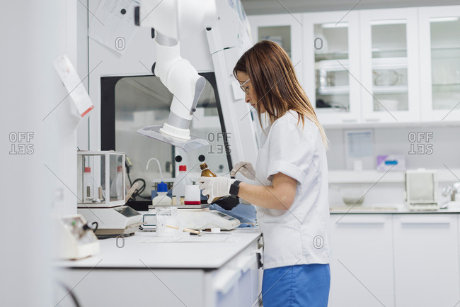 Female scientist with long brown hair working at laboratory