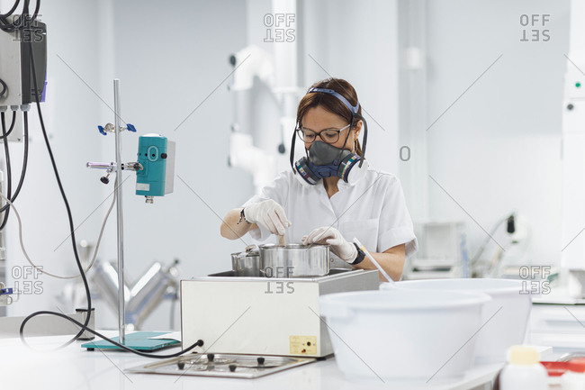 Confident mature female technician doing research in lab