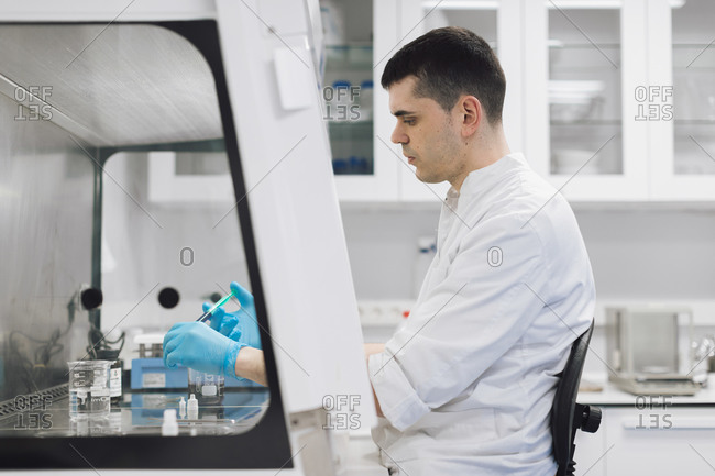 Male healthcare worker doing research in pharmaceutical laboratory