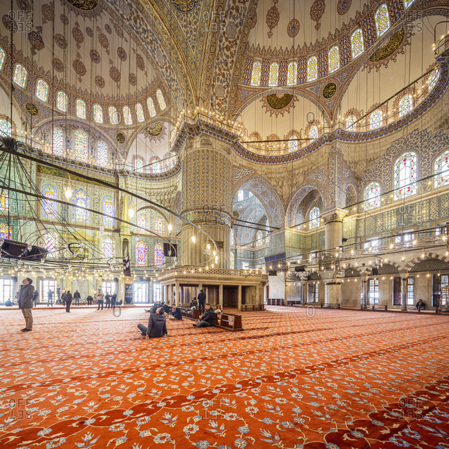 March 26, 2017: Turkey, Istanbul . The interior of Blue Mosque (Sultan Ahmed Mosque or Sultan Ahmet Mosque or Sultan Ahmet Camii). The Blue Mosque was constructed between 1609 and 1616 during the rule of Ahmed I. The interior walls are decorated with hand-painted blue tiles, and at night the mosque is bathed in blue as lights frame the mosque's five main domes, six minarets and eight secondary domes.
