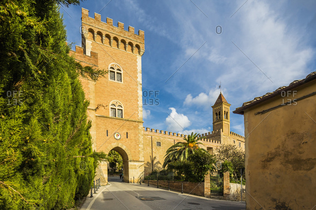 May 16, 2020: Italy, Tuscany, Castagneto Carducci . Bolgheri, Il Castello (The Castle) and the Chiesa (church) dei Santi Giacomo e Cristoforo.