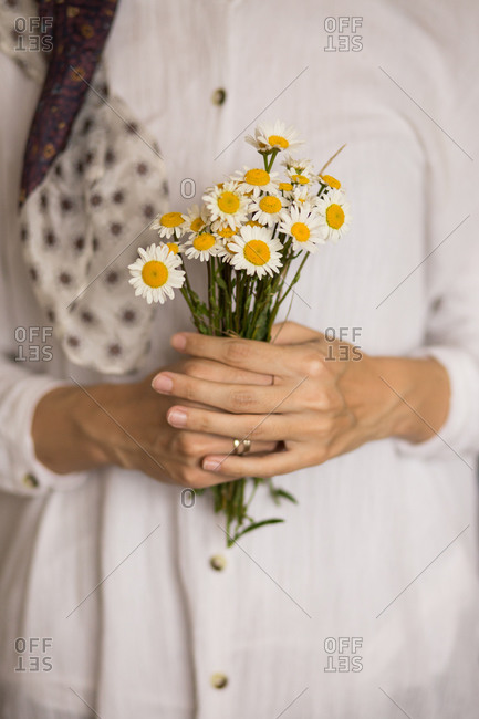 Woman holding a bouquet of fresh picked margarita flowers