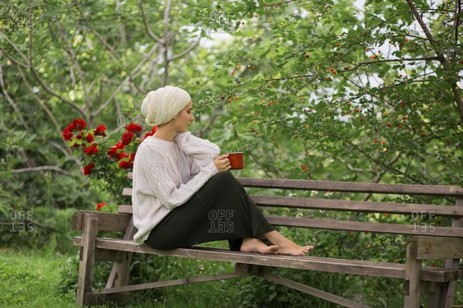 Woman drinking coffee in garden