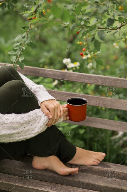 Close up of woman drinking coffee in garden