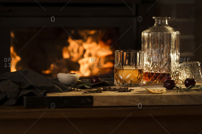 Whiskey cocktail being made beside fire