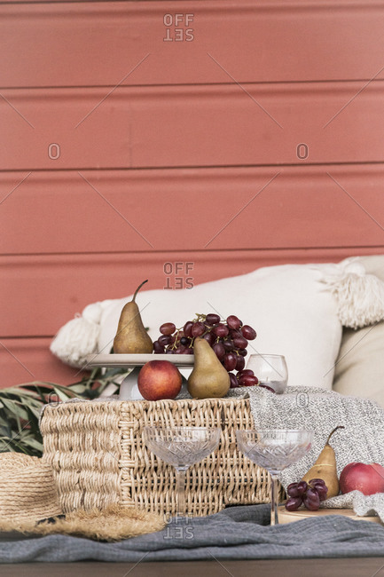 Cozy picnic served on blanket with fruit