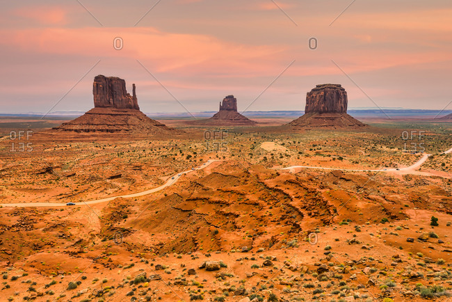 Scenic view of iconic Mitten Buttes with storm clouds in Monument Valley Navajo Tribal Park, Arizona