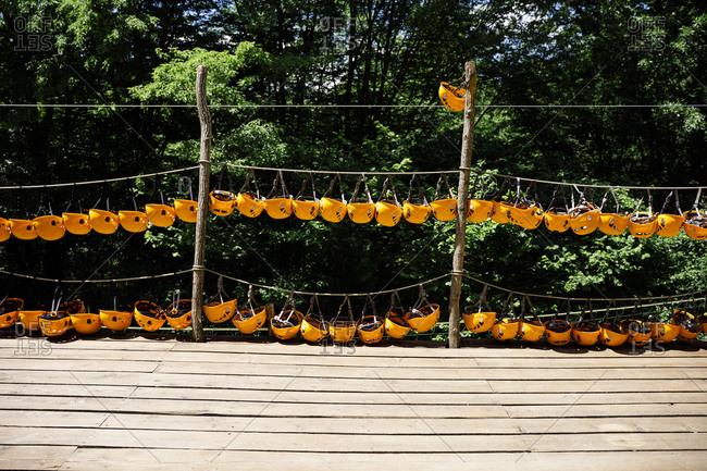Orange rock climbing helmet on a platforms at an Adventure Park