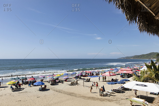 Sayulita, Mexico - June 15, 2018: Crowded beach on a hot summer day