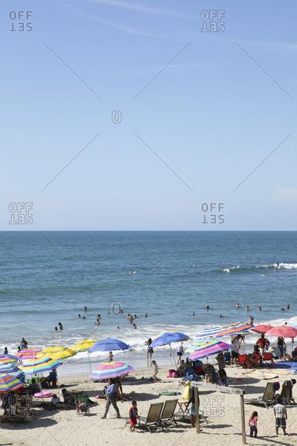 Sayulita, Mexico - June 15, 2018: Crowded beach on the coast of Mexico