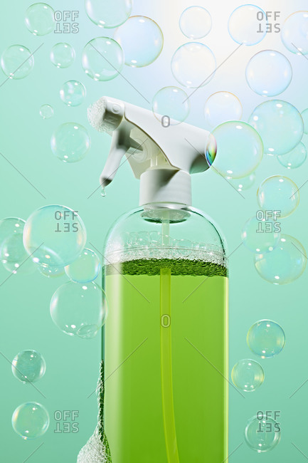 Green cleaning spray bottle with bubbles