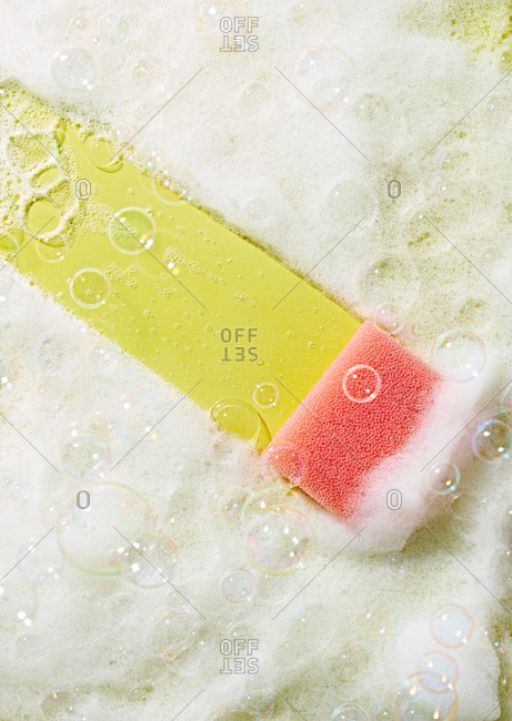 Pink sponge with suds and bubbles