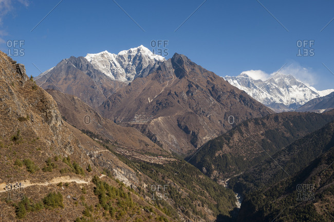The trail to Everest Base Camp with views of Everest far off in the distance a little spindrift coming from its summit