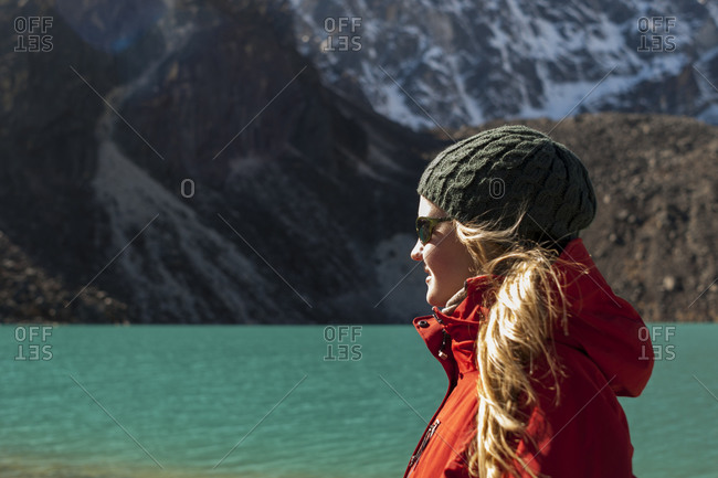 A trekker near the Himalayan glacial lake Taujun in the Gokyo Valley in the Everest region of Nepal