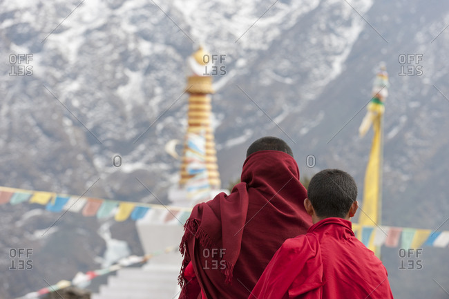 Monks look out from the temple at Tengboche