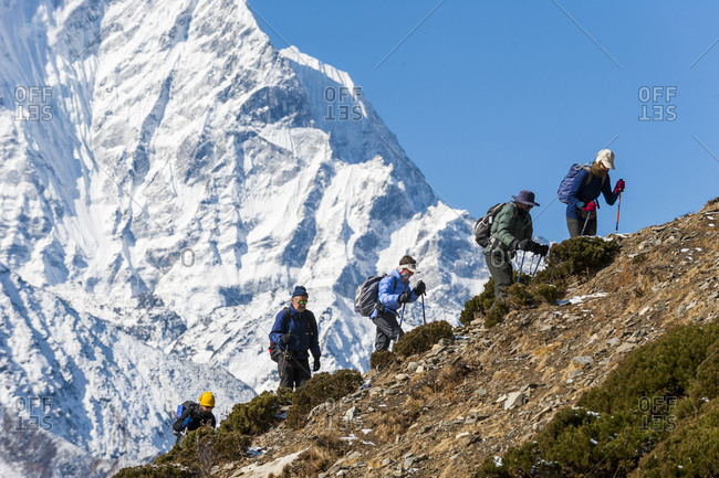 Dingboche, Namche, Khumbu, Everest Region, Nepal - April 10, 2009: Trekkers on their way to Everest base camp with views of Ama Dablam