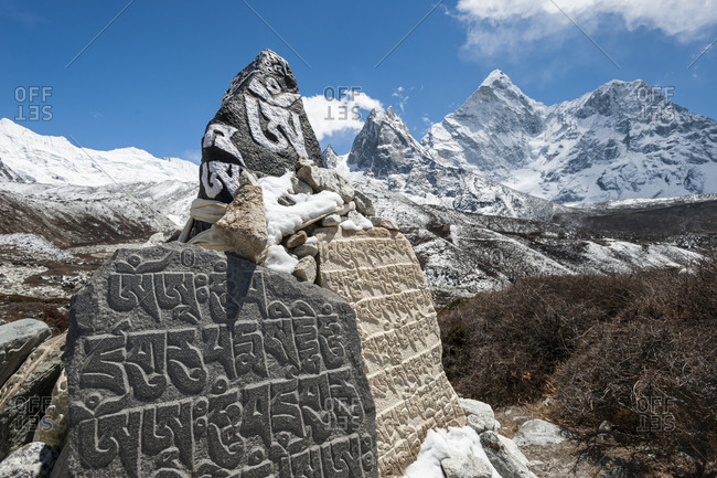Tibetan Mani stones in the Chekhung valley with views of Ama Dablam