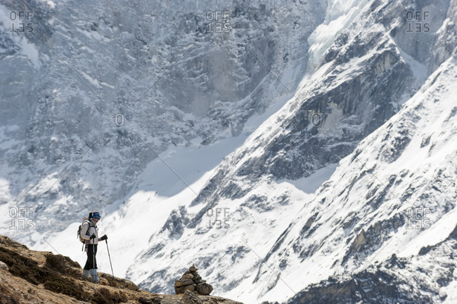 Dingboche, Namche, Khumbu, Everest Region, Nepal - April 11, 2009: A woman makes her way back down from Everest base camp