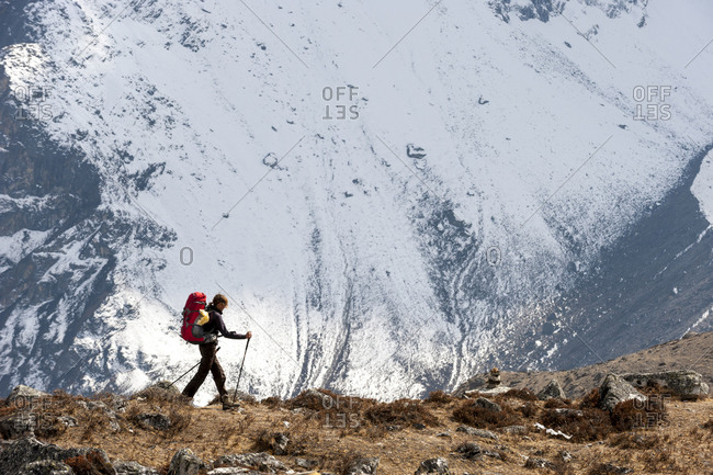 A trekker makes her way to Everest base camp