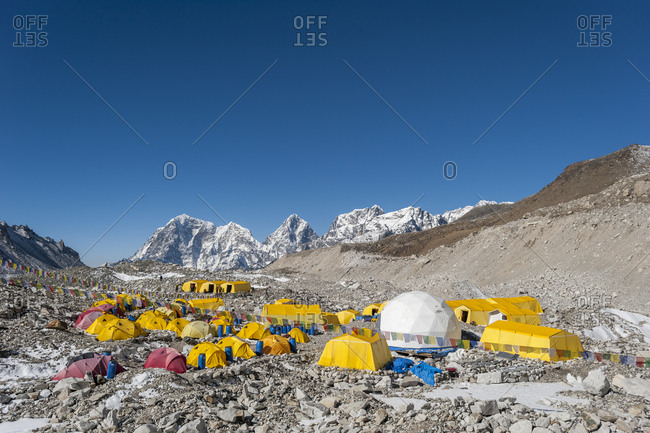 Everest Base Camp, Namche, Khumbu, Everest Region, Nepal - April 13, 2009: Prayer flags adorn climbers tents at Everest base camp in Nepal