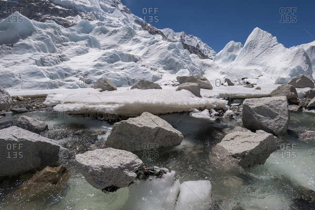 Glacial melt water forms under the Khumbu glacier as the ice melts