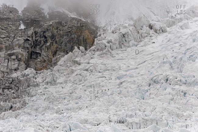 Climbers make their way through the massive seracs and crevases that make the Khumbu ice fall