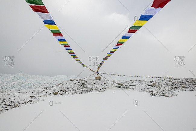 A puja adorned with prayer flags on the Khumbu glacier at Everest base camp in Nepal