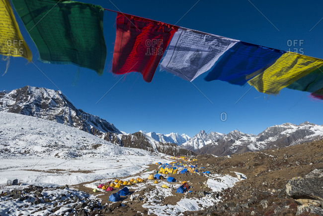 Ama Dablam base camp in the Everest region of Nepal under a string of prayer flags