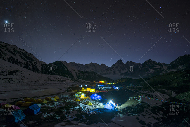 Ama Dablam base camp in the Everest region of Nepal glows under stars
