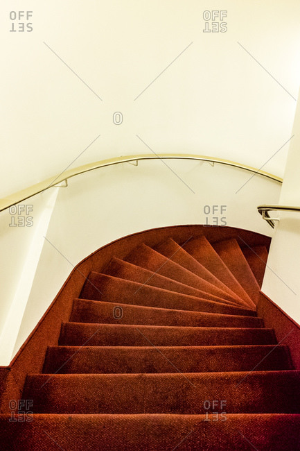 Interior stairway covered in red fabric