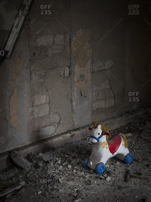 Toy horse in an old dilapidated house