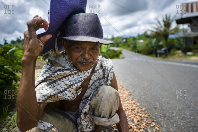 April 27, 2013: Cocoa bean collector, Sulawesi, Indonesia