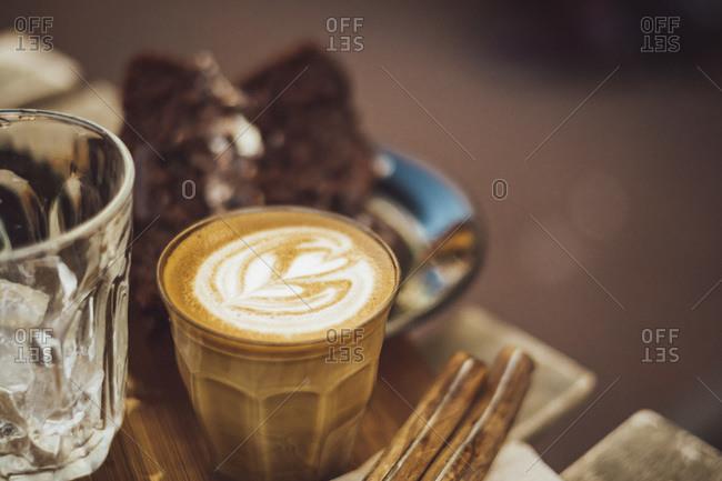 Coffee in a glass with heart-shaped milk foam