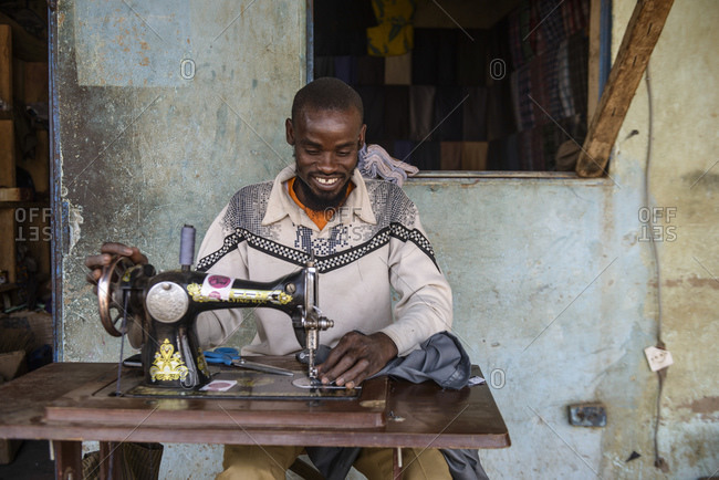 December 10, 2015: Burkinabe street tailor, Burkina Faso