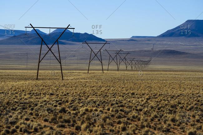 Electricity pylon through the Namibian desert, Namibia, Africa