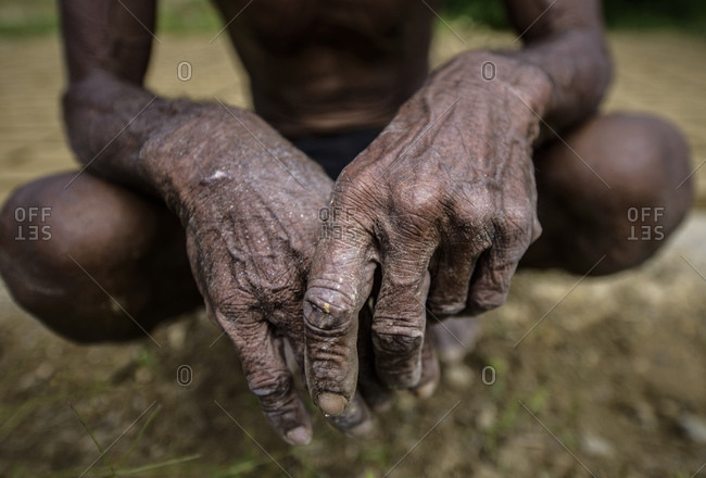 Hands of a brick maker, western Sulawesi, Indonesia