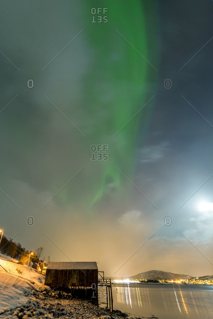 Northern lights in the Kaldfjord on Kvaloya, Norway