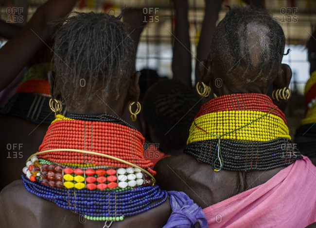 Turkana women's typical necklaces, earrings and hairstyle, Kenya
