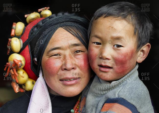April 3, 2011: Tibetan mother with son, Tibetan plateau