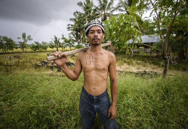 April 5, 2013: Farmer in the field, Sulawesi, Indonesia