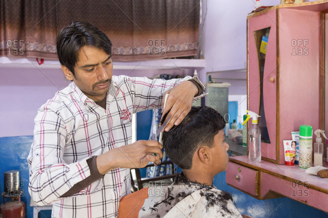 February 7, 2016: Barber and Hairdresser, Nawalgarh, Rajasthan, India