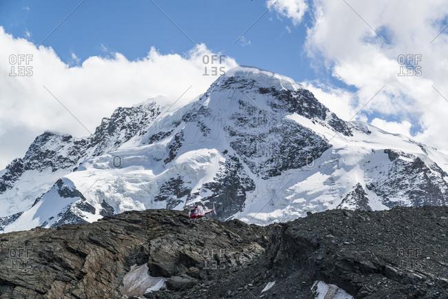 Helicopter below the Breithorn, mountain ridge, Valais Alps, Switzerland