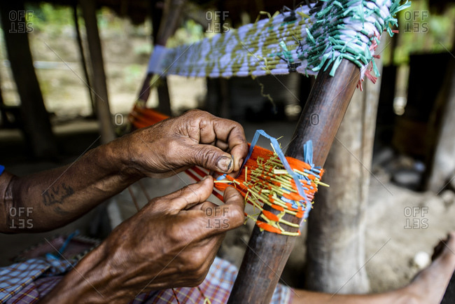 Woman from West Timor works on an Ikat, Indonesia